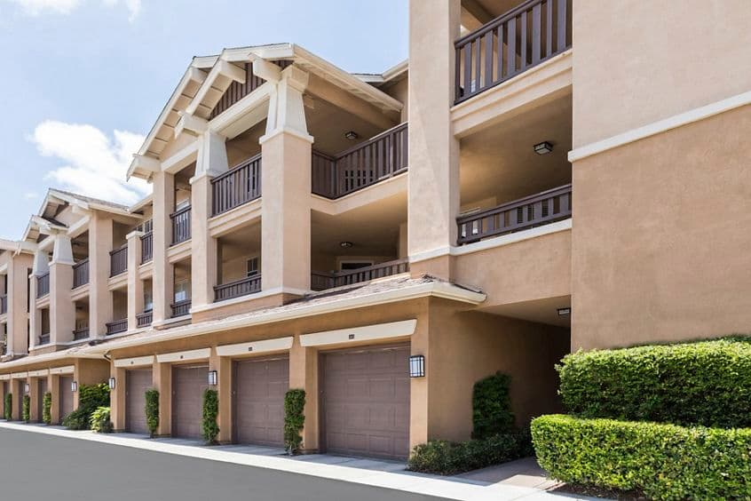 Exterior view of parking garages at Arcadia at Stonecrest Village Apartment Homes in San Diego, CA.