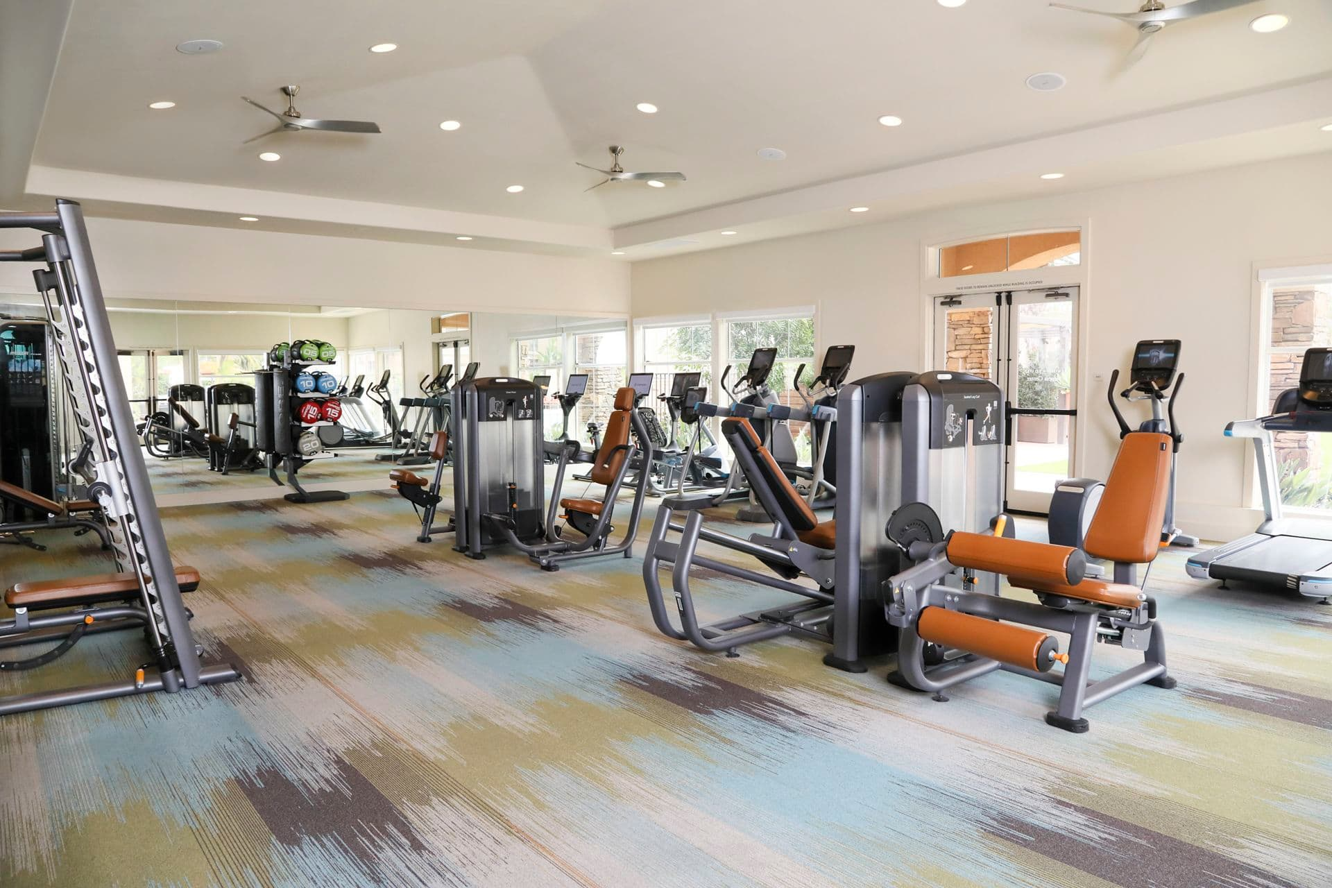 Interior view of fitness center at Del Rio Apartment Homes in Mission Valley, CA.