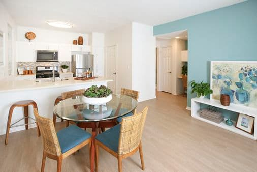 Interior view of kitchen and dining room at Del Rio Apartment Homes in Mission Valley, CA.