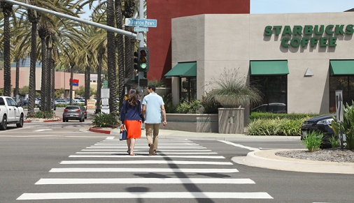 Couple crossing the street at Del Rio Apartment Homes in Mission Valley, CA.