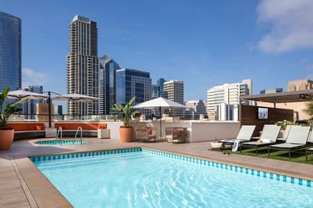 Exterior view of roof deck pool at Harborview Apartment Homes in San Diego, CA.