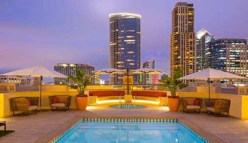 Exterior view of rooftop pool at Harborview Apartment Homes in San Diego, CA.