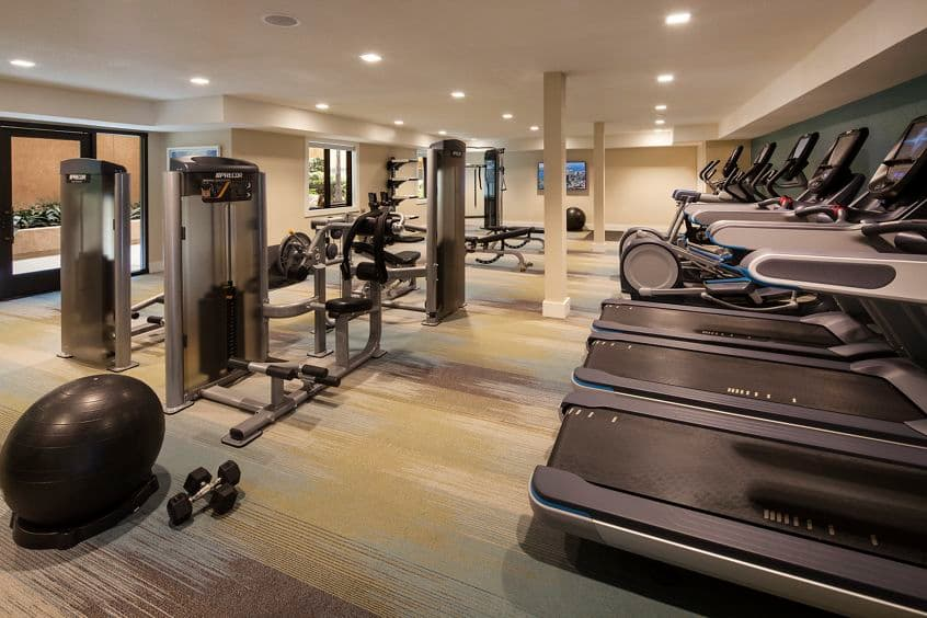 Interior view of fitness center at Harborview Apartment Homes in San Diego, CA.