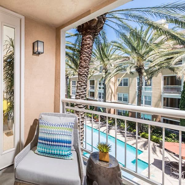 Interior view of patio overlooking the pool at La Jolla Palms Apartment Homes in San Diego, CA.
