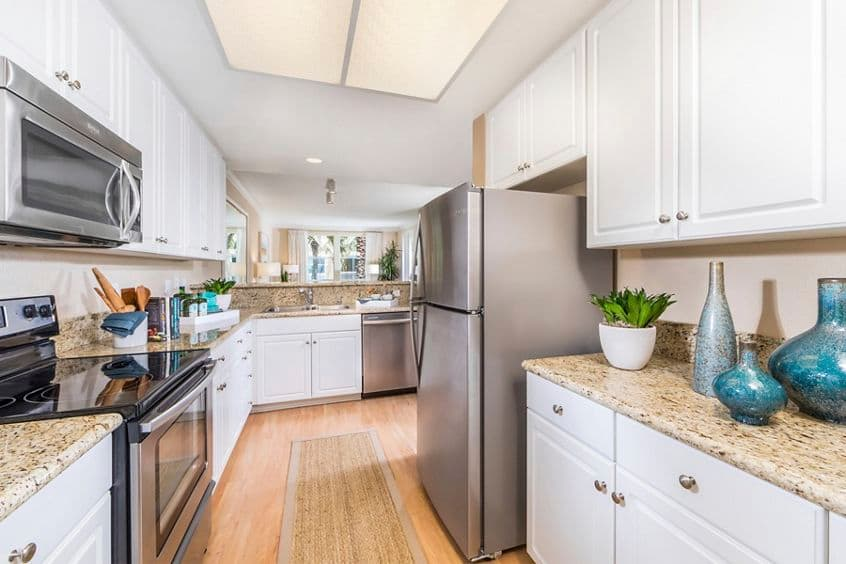 Interior view of kitchen at La Jolla Palms Apartment Homes in San Diego, CA.