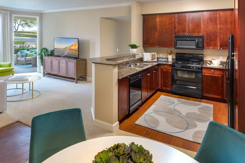 Interior view of kitchen and dining at Marbella Apartment Homes in San Diego, CA.