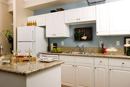 Interior view of kitchen at Monte Vista Apartment Homes in Mission Valley, CA.