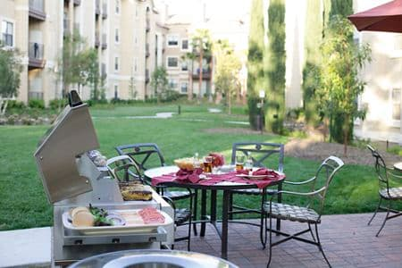 Exterior view of BBQ grill and outdoor patio at Monte Vista Apartment Homes in Mission Valley, CA.