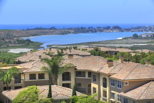 Exterior view of lagoon and ocean at Pacific View Apartment Homes in San Diego, CA.