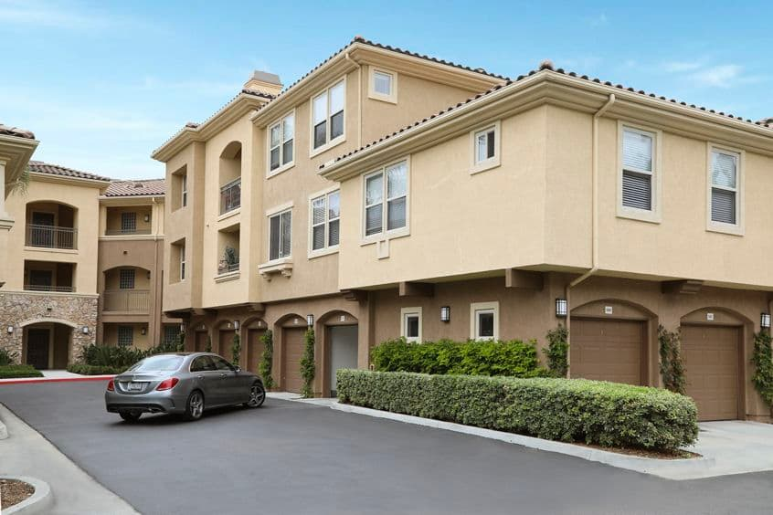 Exterior view of home parking garage at Pacific View Apartment Homes in Carlsbad, CA.