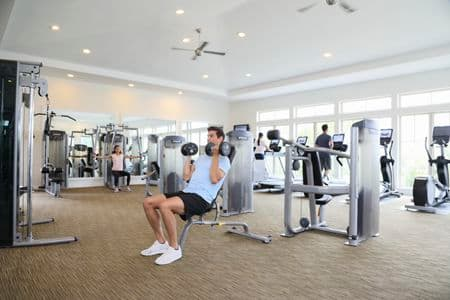 People exercising at fitness center at Pacific View Apartment Homes in Carlsbad, CA.
