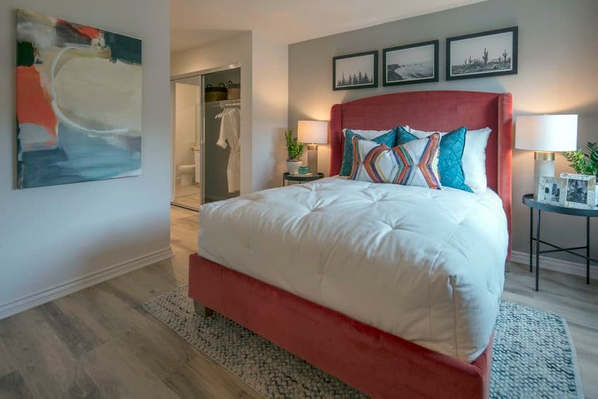 Interior view of bedroom at Seascape Apartment Homes in Carlsbad, CA.