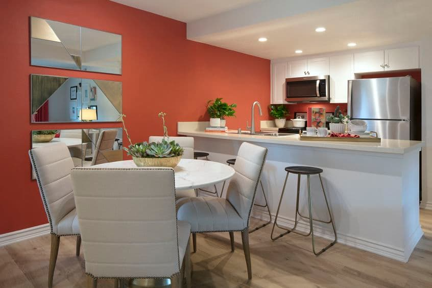 Interior view of dining and kitchen areas at Seascape Apartment Homes in Carlsbad, CA.