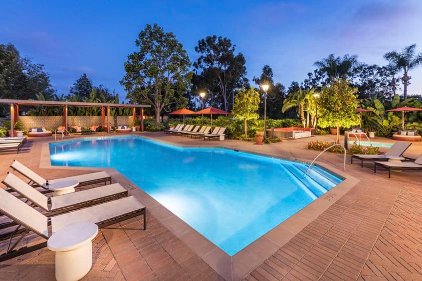 Exterior evening pool view at Seascape Apartment Homes in Carlsbad, CA.