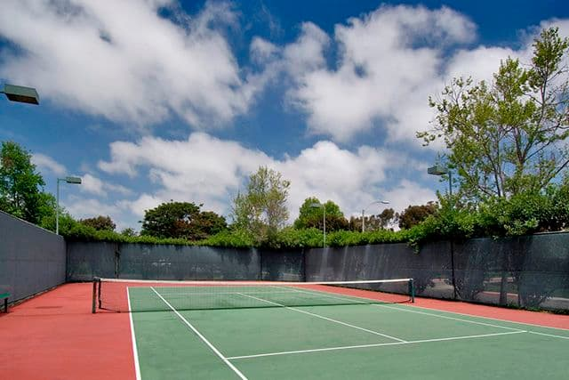 Exterior views of tennis courts at Seascape Apartment Homes. Off-Ranch in Carlsbad, CA.