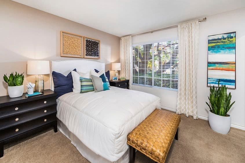 Interior view of bedroom at Solazzo Apartment Homes in La Jolla, CA.