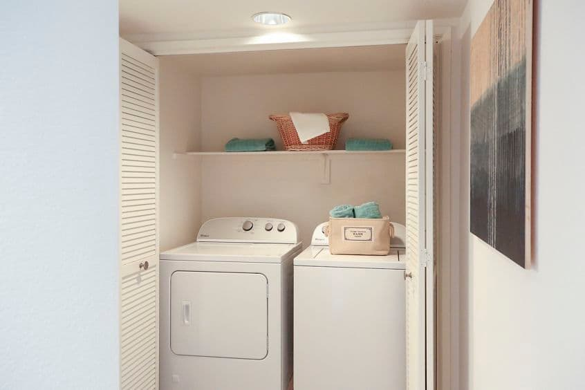 Interior view of laundry room at Solazzo Apartment Homes in La Jolla, CA.