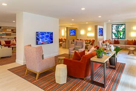 Interior view of clubhouse at The Village Mission Valley Apartment Homes in San Diego, CA.