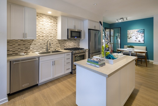 Interior view of kitchen of The Village Mission Valley Apartment Homes in San Diego, CA.