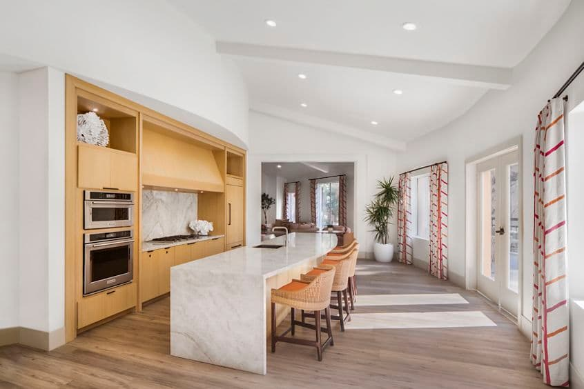 Interior view of kitchen in clubhouse at The Villas of Renaissance Apartment Homes in San Diego, CA.