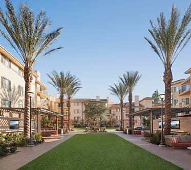 Exterior view of lawn courtyard at The Villas of Renaissance in San Diego, CA.
