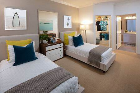 Interior view of bedroom at The Villas of Renaissance Apartment Homes in San Diego, CA.