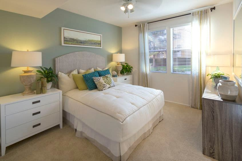 Interior view of bedroom at Torrey Hills Apartment Homes in San Diego, CA.
