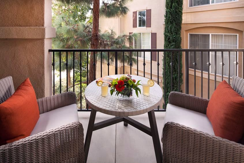 Exterior view of patio balcony at Torrey Villas Apartment Homes in San Diego, CA.