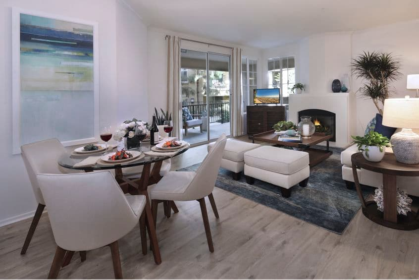 Interior view of dining room and living room at Torrey Villas Apartment Homes in San Diego, CA.