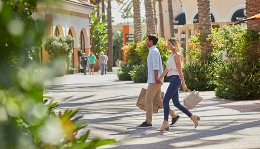 Exterior view of couple shopping at Irvine Spectrum Center in Irvine, CA.