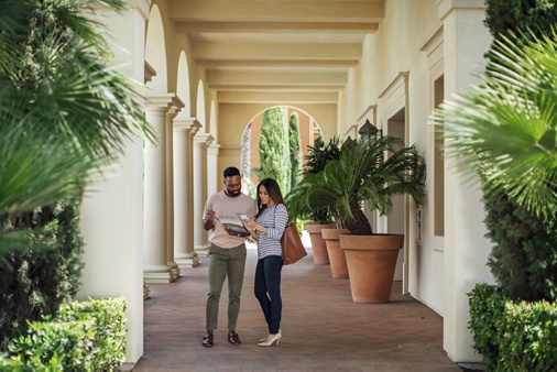 Exterior view of couple on Self Guided Tour of Irvine Company Apartment Communities.