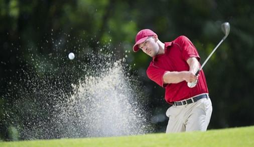 Golfer playing shot.