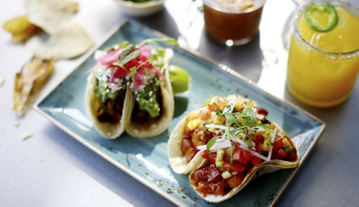 Mexican street tacos with fresh salsa and a margarita