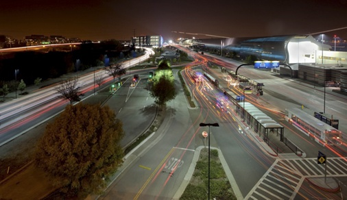 Light trails of cars and planes at San Jose airport at night.