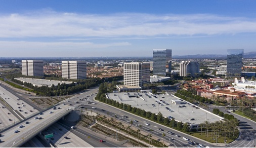 Aerial view of the Irvine, California skyline on a gorgeous day with the 405 Freeway passing underneath.