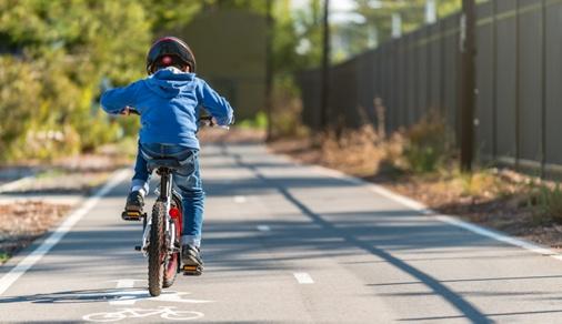 Australian boy riding his bicycle on bike lane on a day, South Australia