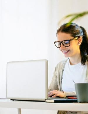 barcelona,Catalunya,Spain, Young woman working at modern home office.
