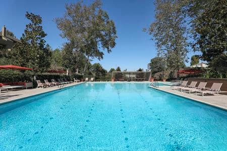 Exterior view of pool at Baywood Apartment Homes in Newport Beach, CA.