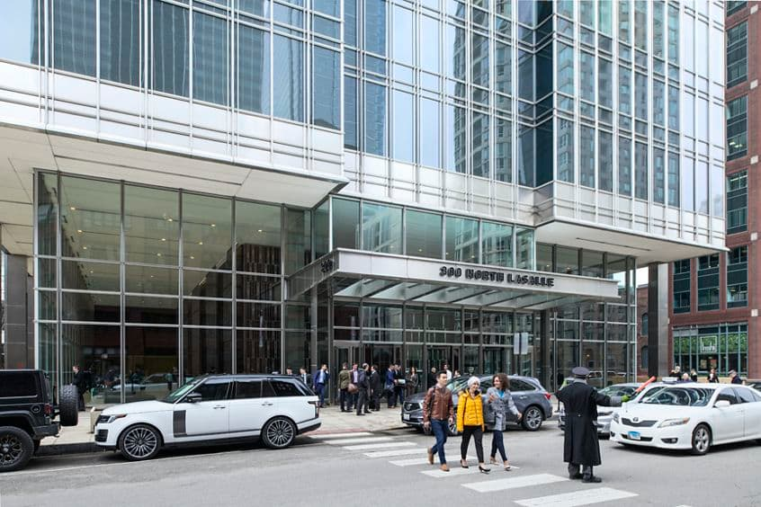Lfiestyle photography of the building exterior and crosswalk at 300 North LaSalle in Chicago, IL