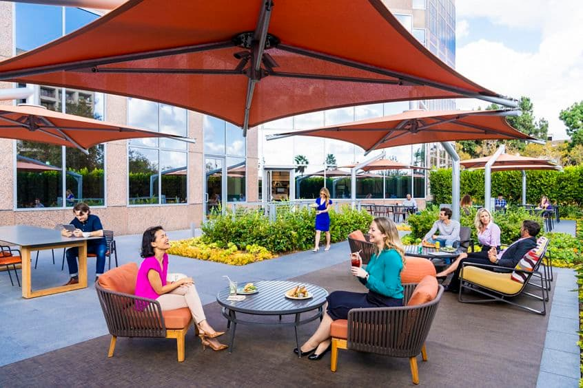 Exterior view of people at patio at Pacific Kitchen Market at 2121 Avenue of the Stars Office Properties in Los Angeles, CA.