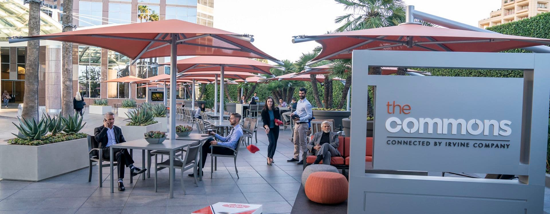 Exterior view of people at The Commons at 2121 Avenue of the Stars Office Properties in Los Angeles, CA.