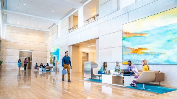 Lifestyle photography of the building lobby at 100 Spectrum Center Drive in Irvine, CA