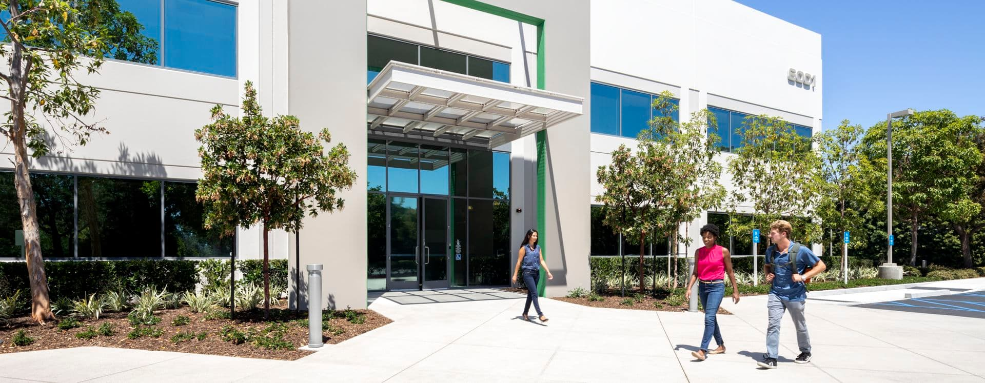 Lifestyle photography of the building entry at Oak Canyon Business Center - 6001 Oak Canyon in Irvine, CA