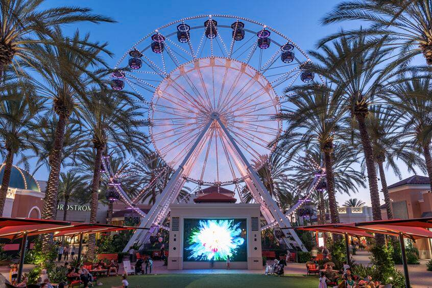 Evening view of the Giant Wheel Court at Irvine Spectrum Center in Irvine, CA.