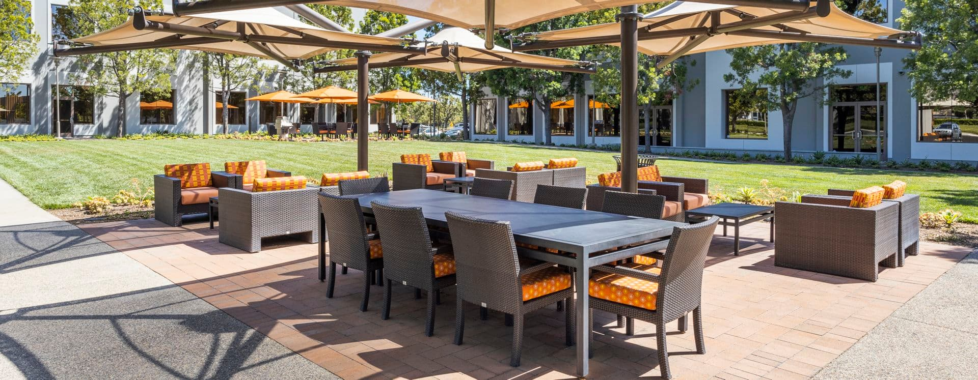 Exterior view of seating area in The Commons at 410 Exchange at Market Place Center in Irvine, CA.
