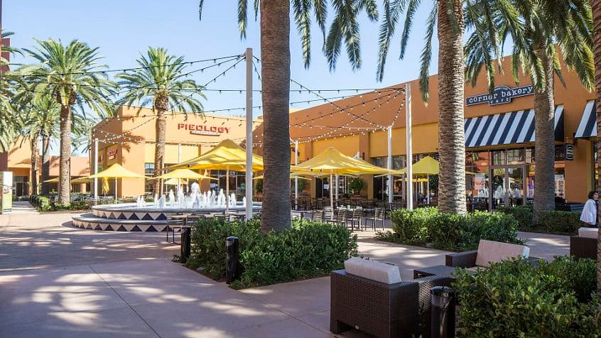 Exterior courtyard of Market Place Center featuring Corner Bakery and Pieology