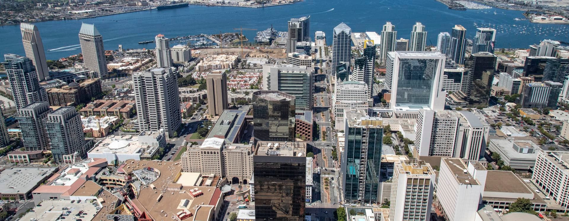 Aerial photography of downtown San Diego featuring 225 Broadway, 101 West Broadway, One America Plaza, and 501 West Broadway in San Diego, CA