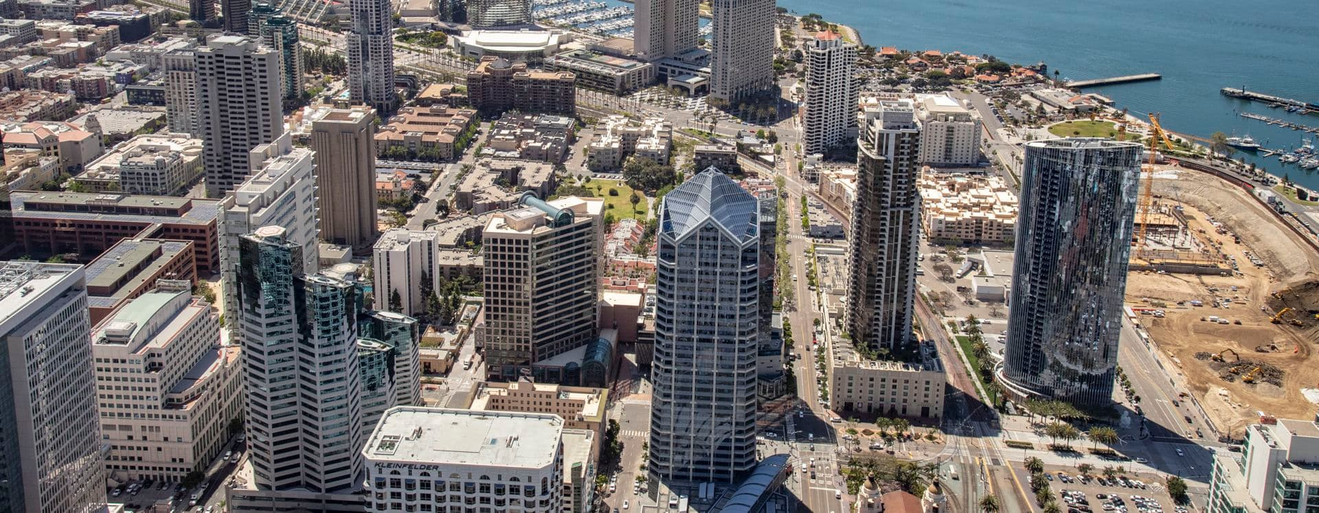 Aerial photography of downtown San Diego featuring One America Plaza and 501 West Broadway in San Diego, CA