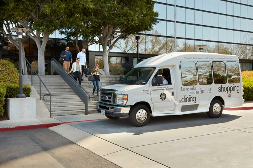 Customer Convenience Shuttle in front of 3131 Camino Del Rio office building at Centerside.