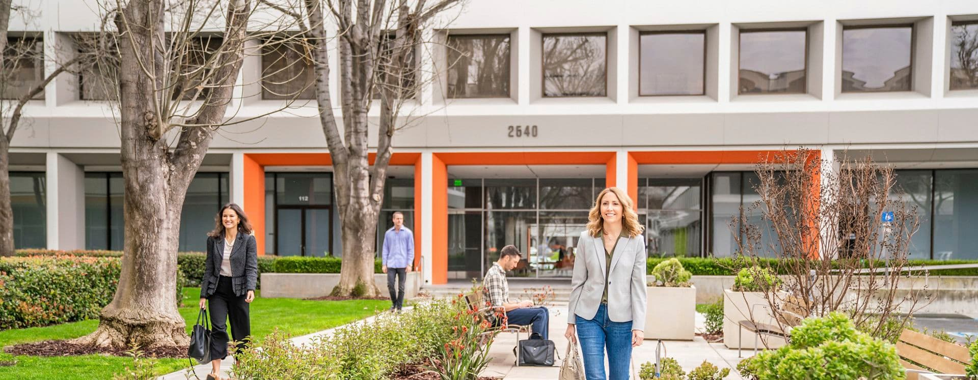Lifestyle photography of the building entrance of SIlicon Valley Center - 2540 N First Street in San Jose, CA